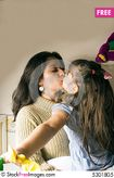 Mother And A Daughter Kissing  Free Stock Photos & Images  5301805