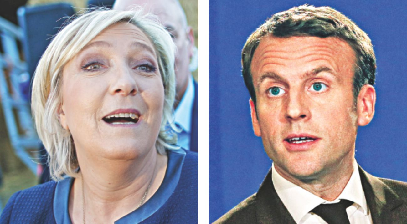 Le Pen, Macron hold rival rallies