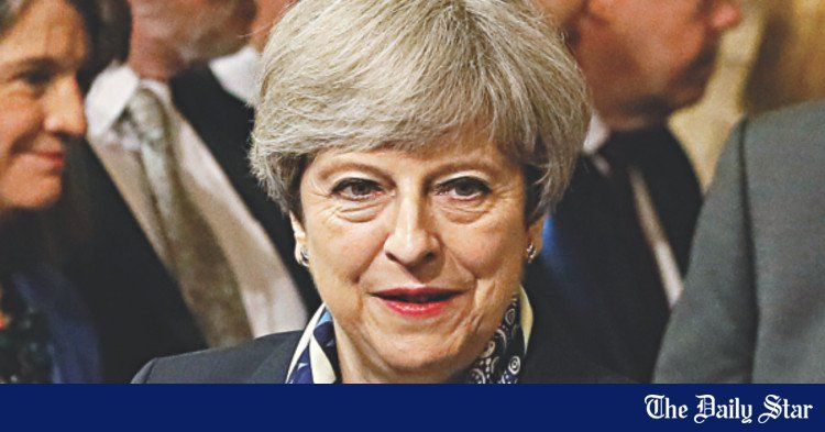 May softens tone on Brexit