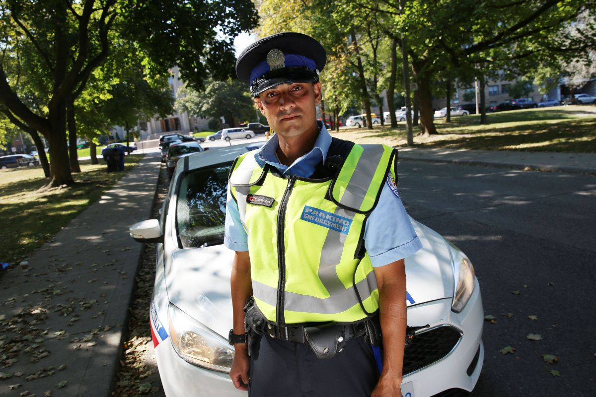 Fists, spittle, hot coffee . . . all in a day's work for a Toronto parking officer
