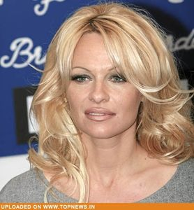 Pamela Anderson walks down the aisle again but only for a music video!