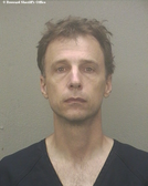 Thomas Edler, 48, of Weston, is accused of taking more than 100 photos