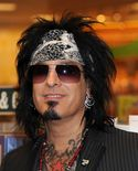 "Nikki Sixx Musician Nikki Sixx signs copies of ""This Is Gonna Hurt"" at"
