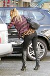 seethrough leggings as she loads her car for a weekend away with her