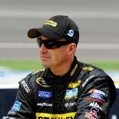 Marcos Ambrose, Driver Of The #9 Stanley Ford, Stands On The Grid