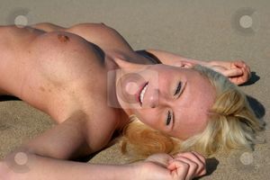 beauty relaxes on a beach (gunnison beach NJ) by Gregg Cerenzio