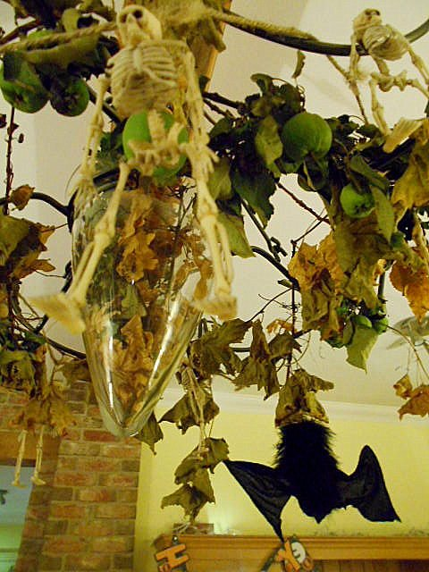 Bats and skeletons hanging from the chandelier.....  by snowy