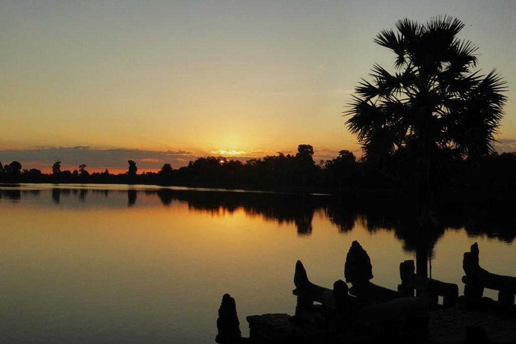 Cambodia Sunrise at Sra Srang  by helenhall
