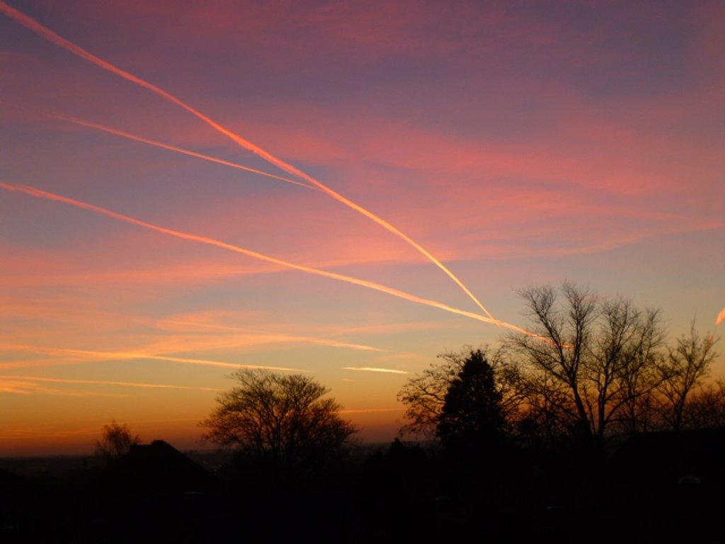 Sunrise Reflection on Contrails by 30pics4jackiesdiamond