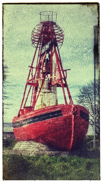 Preston Docklands entrance - grounded Nelson red 'bell-boat' buoy. by lyndamcg