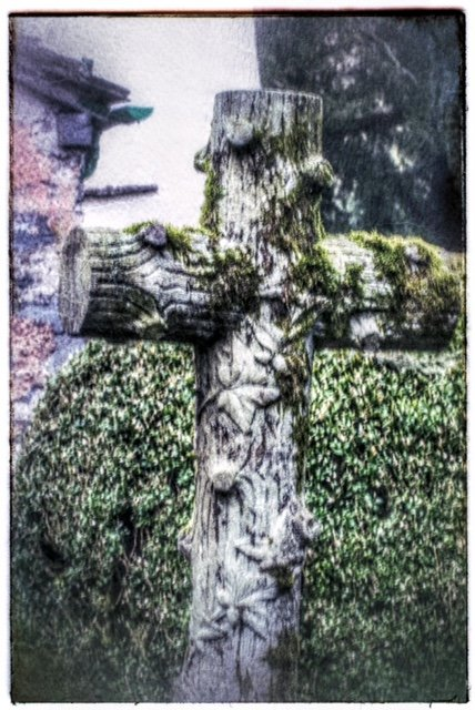 This cross caught my eye in the graveyard of the church at Grasmere by lyndamcg