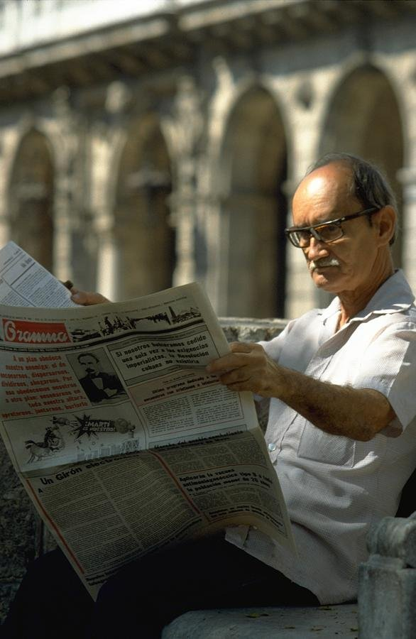 65 Reading The News in Havana by travel
