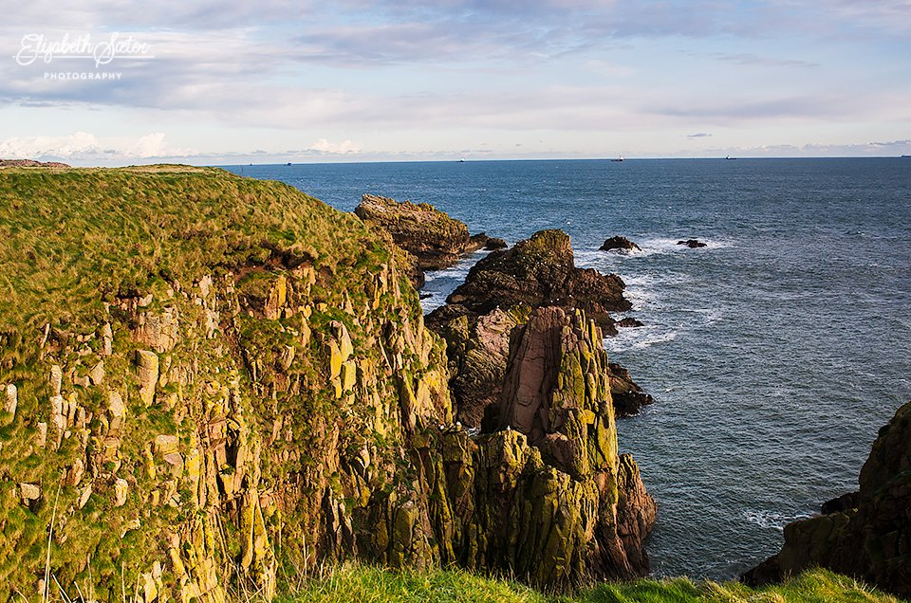 The cliffs at Slains Castle by elisasaeter