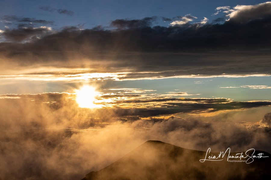 Setting sun from Mauna Kea Summit by princessleia