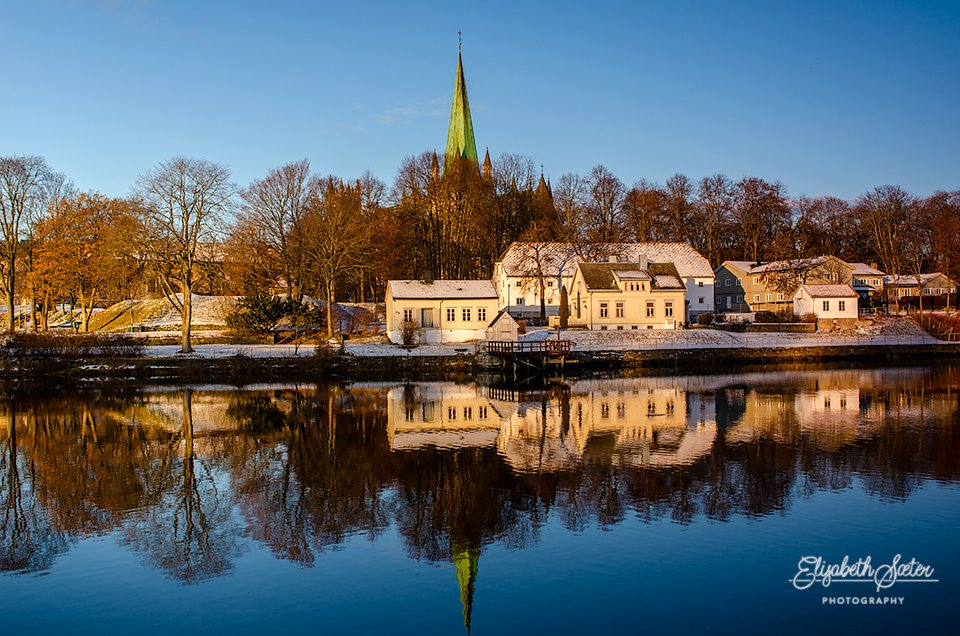 Reflections in Nidelven( river Nid ) by elisasaeter