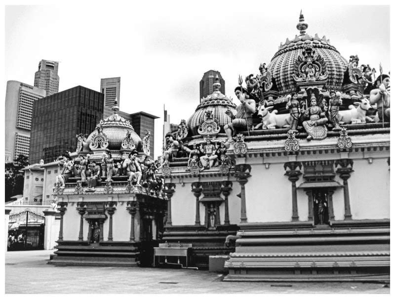 The ornate temples in Singapore against the modern skyscrapers by lyndamcg