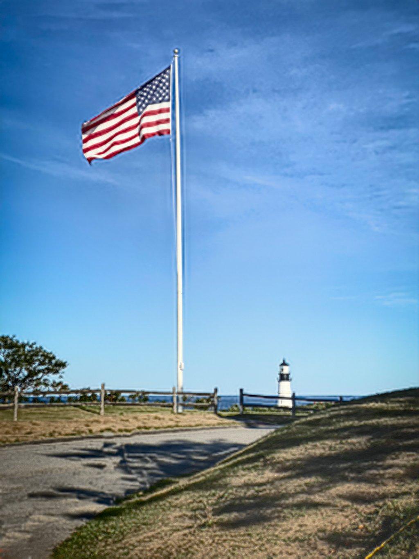 Flag and Lighthouse by joansmor