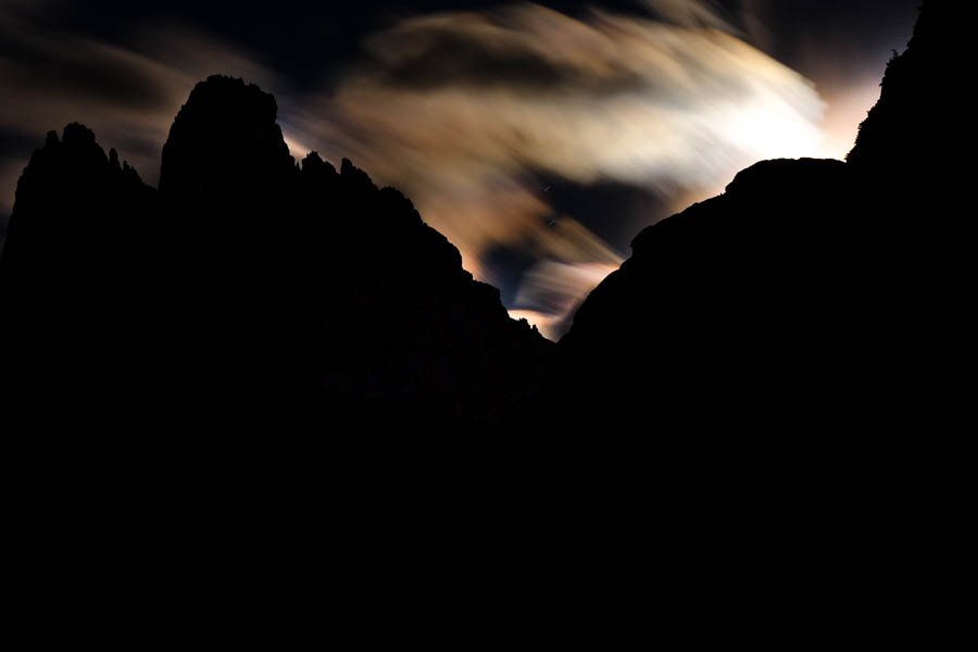 Moon hiding behind the mountains by caterina