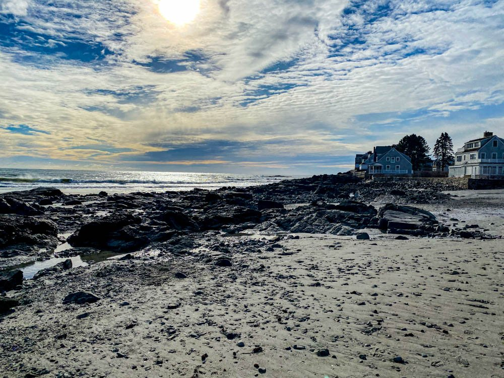 Sun over winter beach by joansmor