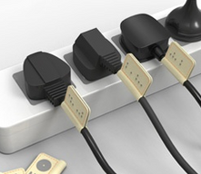 Des marqueurs de prises électriques, en braille