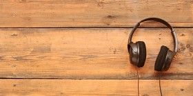 stylish headphones on a grungy wooden table