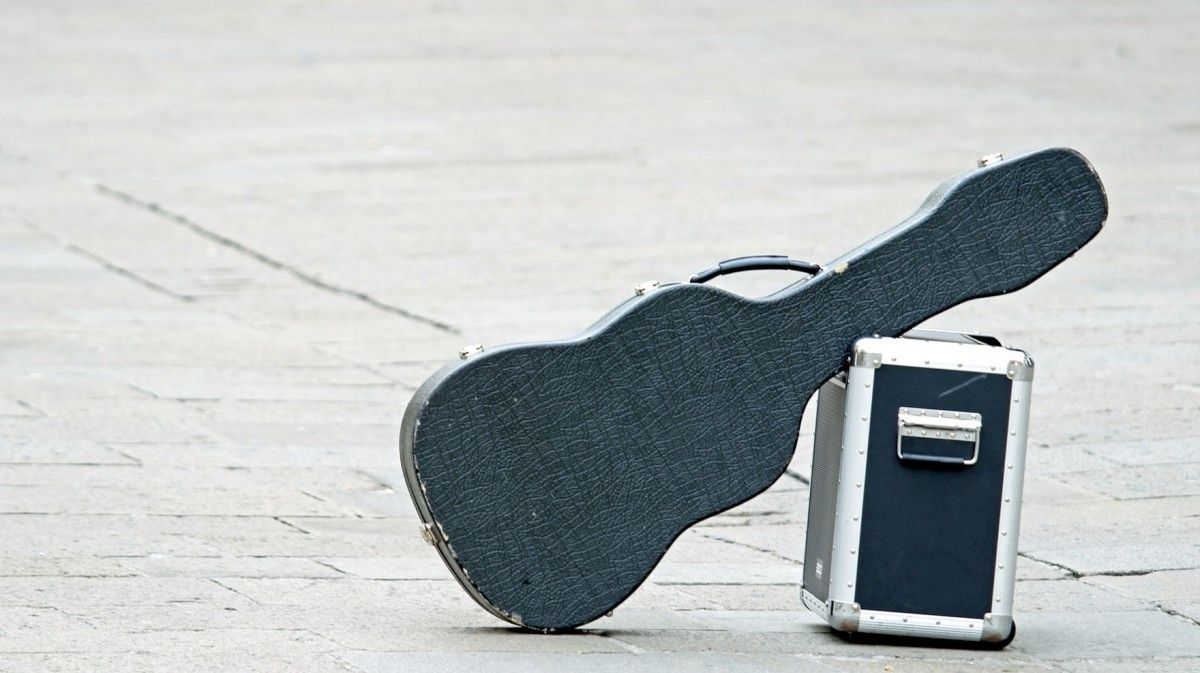 Black guitar with amplifier isolated abandoned in an isolated place