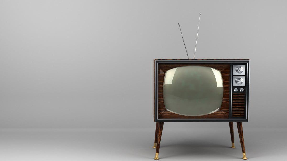 Classic vintage TV with wood veneer design in studio