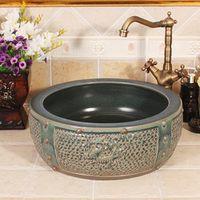 Antique bronze totem Carving Design Europe Vintage Style Ceramic Art Basin Sinks Counter Top high quality ceramic wash basin