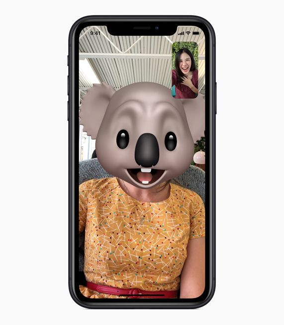 iPhone XR with Animoji FaceTime on screen.