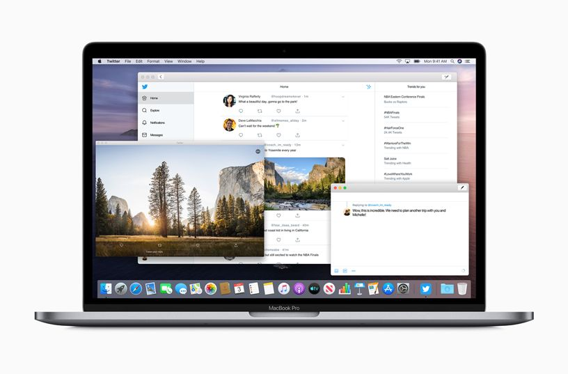 MacBook Pro with several app windows open.