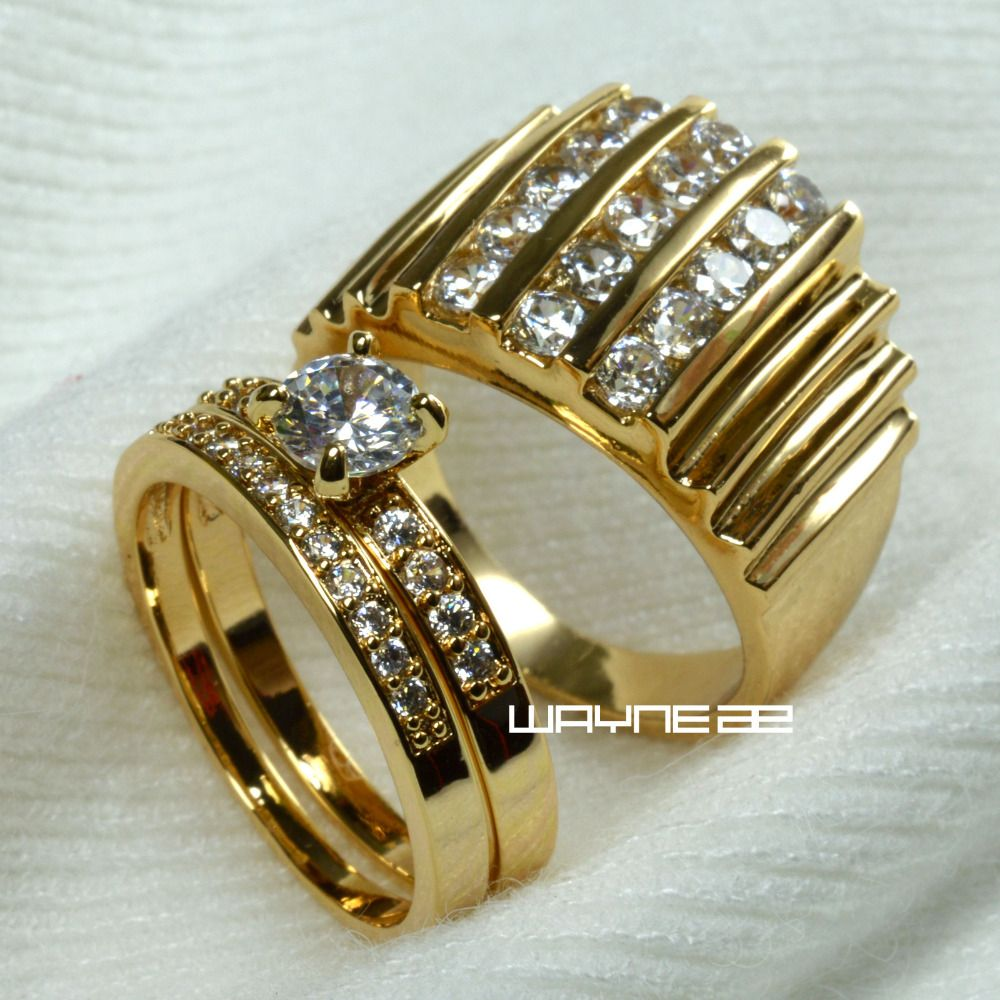 Set gold tone ENGAGEMENT RING BAND for men and women  R117,280 men size 9-15; women size 6-10