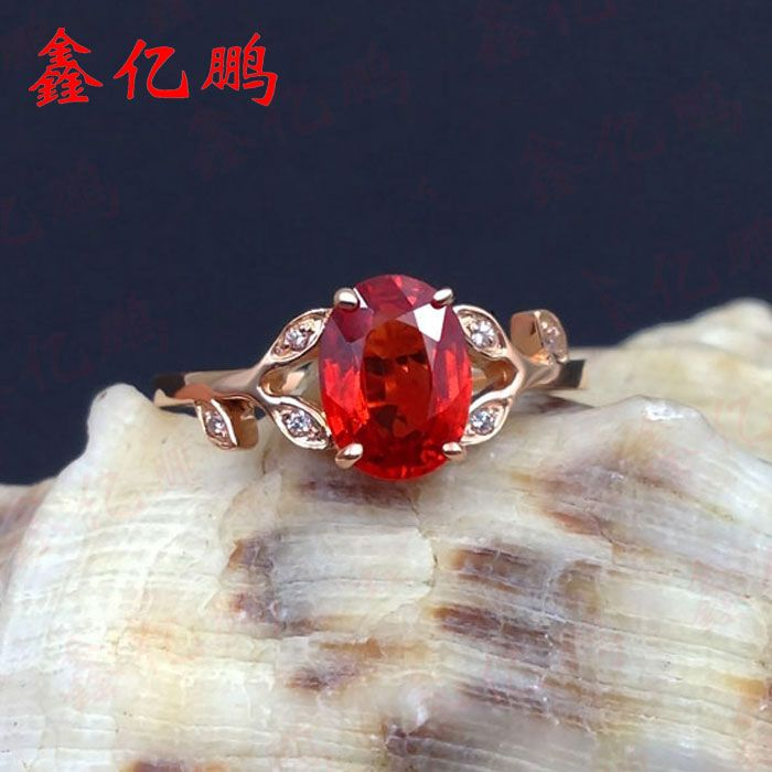 18 k gold with orange red sapphire ring heating with female ring 1.5 carats