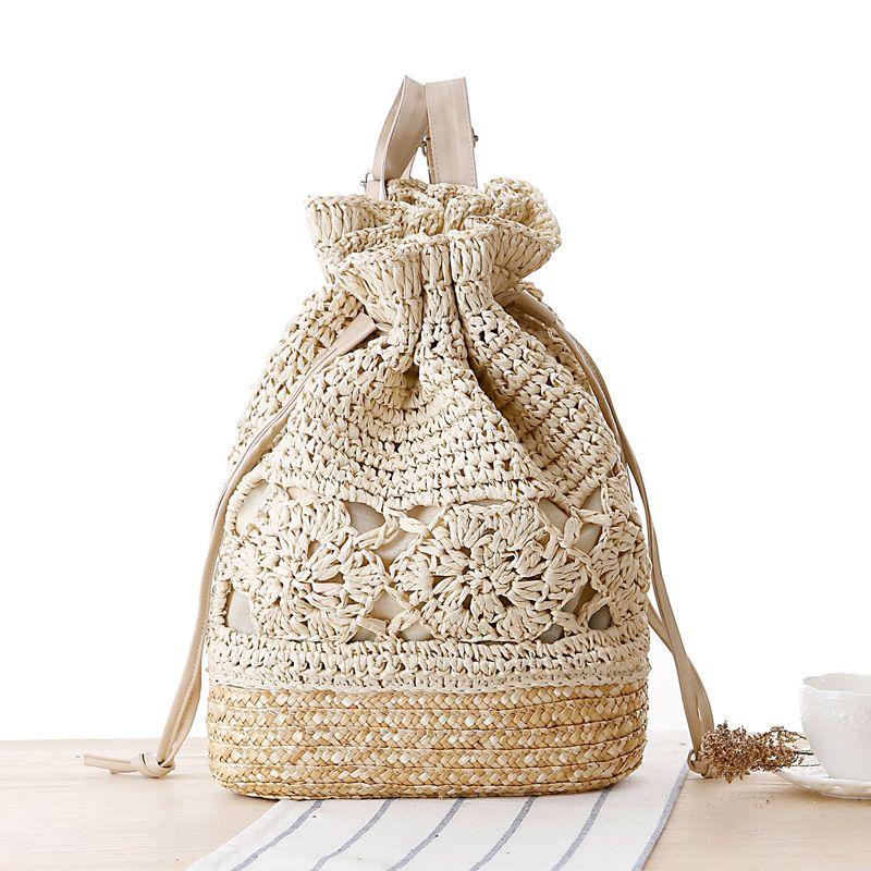 SUDS été cordon dentelle Crochet paille plage sacs Designer haute qualité femme évider fleur à la main tricoté sac à dos