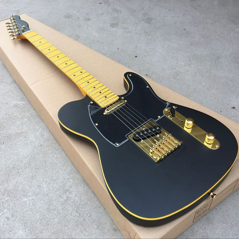 Free shipping wholsale electric guitarra TL guitarra/black color Golden accessories The real picture
