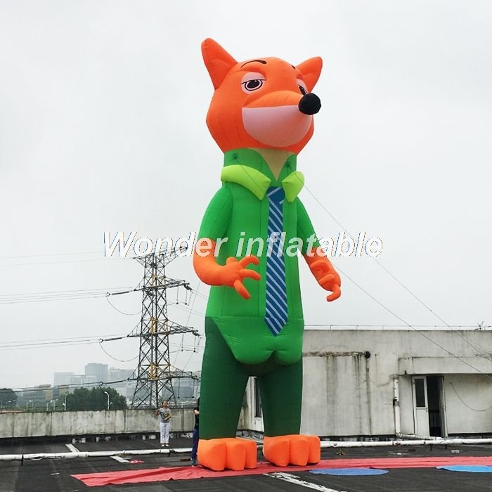 Custom made giant inflatable fox character in clothing for event advertising