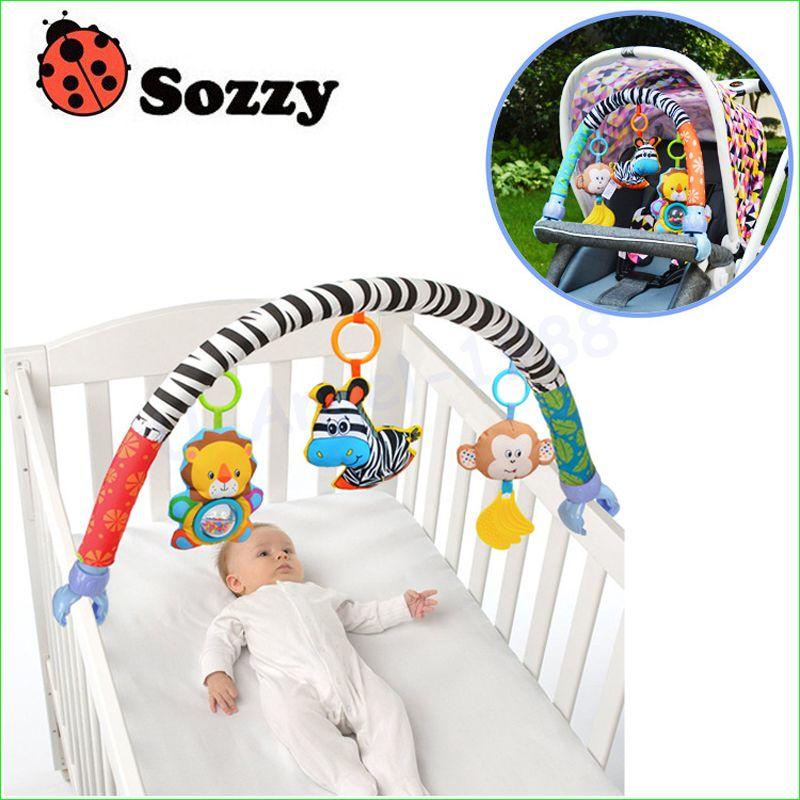 1 unids Sozzy bebé colgando bebé elefante azul y rosa conejito juguete de la música Cama de Bebé y Cochecito de Bebé de Juguete Sonajero
