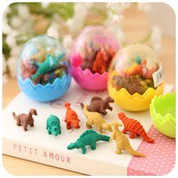 8 unids/set mini Borrador de goma dinosaurio lindo huevo caja escuela Oficina papelería color al azar 5*4 cm