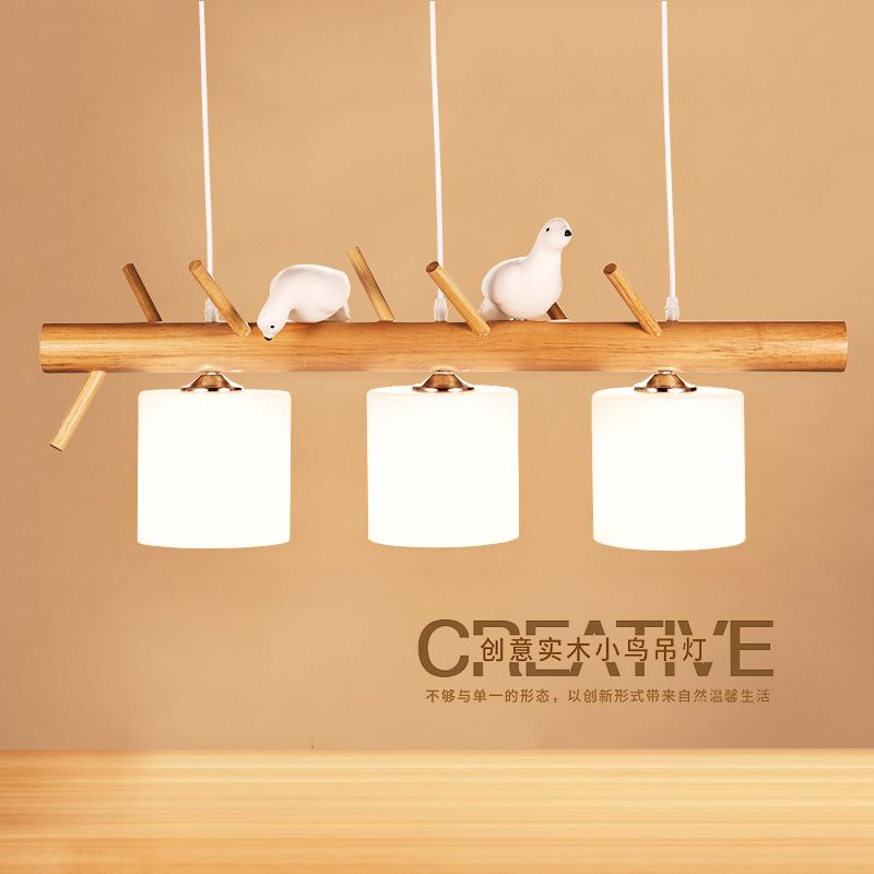 Nordic three Japanese restaurant droplight contracted logs dining room creative arts study stage solid wooden bird lamps