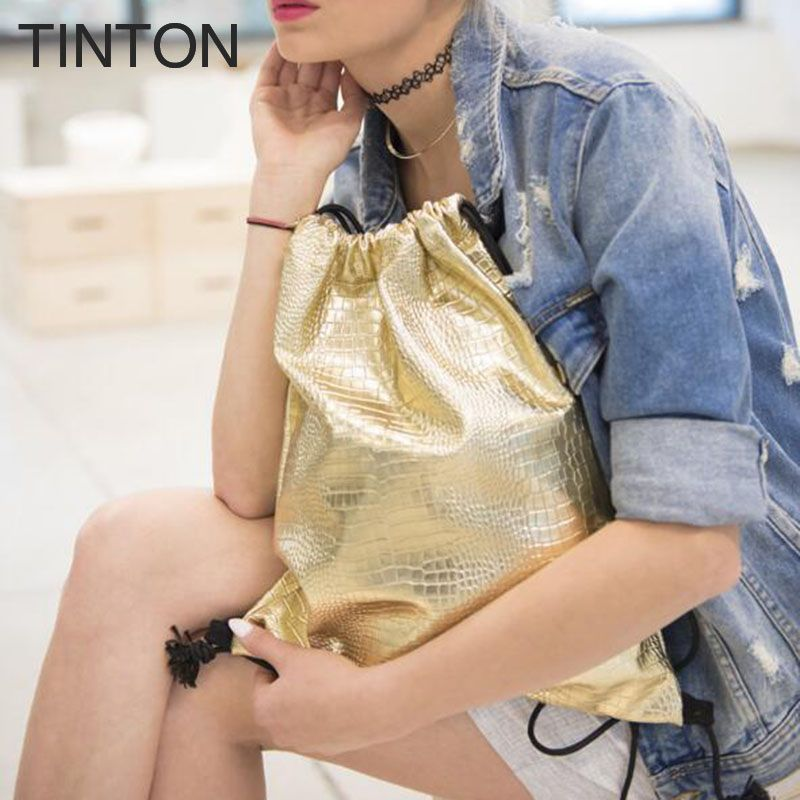 2018 new fashion waterproof soft drawstring pattern bag woman personality embossed bag girl Korean version of the backpack gift