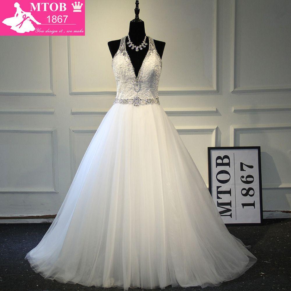 Sexy Deep V Masajeadores de cuello backless robe de mariee magnífico brillante cristales Vestidos de novia vestido de Noiva mtob1725