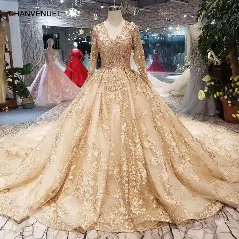 LSS219 goldene spitze hochzeit kleider 2019 champagne v-ausschnitt mit langen ärmeln spitze up zurück hochzeit kleid mit glänzenden königlichen zug
