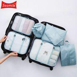 Nueva alta calidad 7 unids/set conjunto bolsa de viaje mujeres hombres equipaje organizador para la ropa zapato impermeable embalaje Cube ropa portátil