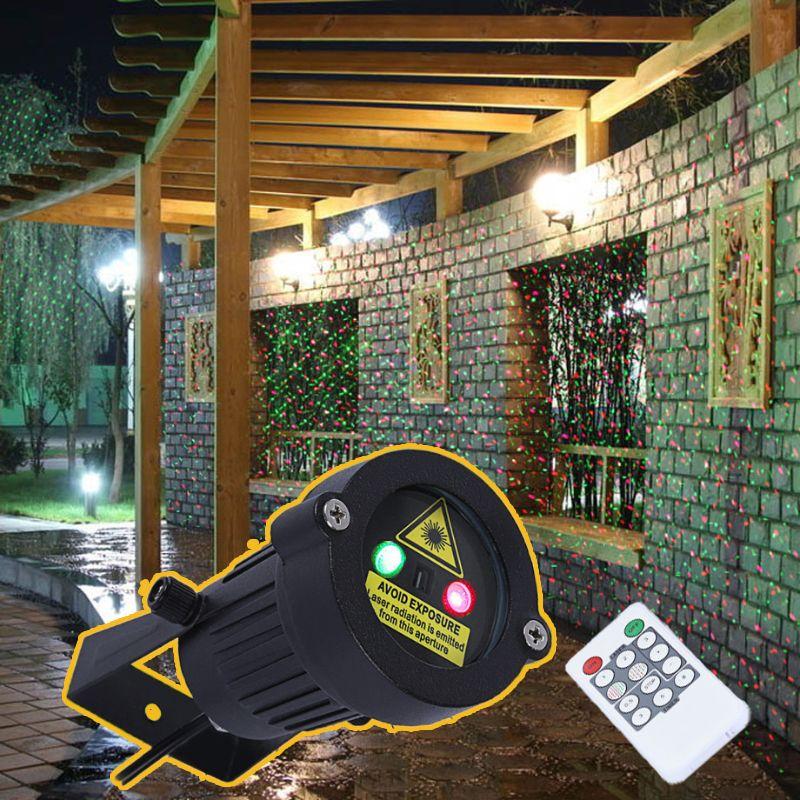 De primera calidad Al Aire Libre Decoración Del Jardín Impermeable IP65 Proyector Proyector de Estrellas de Luz Láser de Navidad Duchas Con Mando a distancia