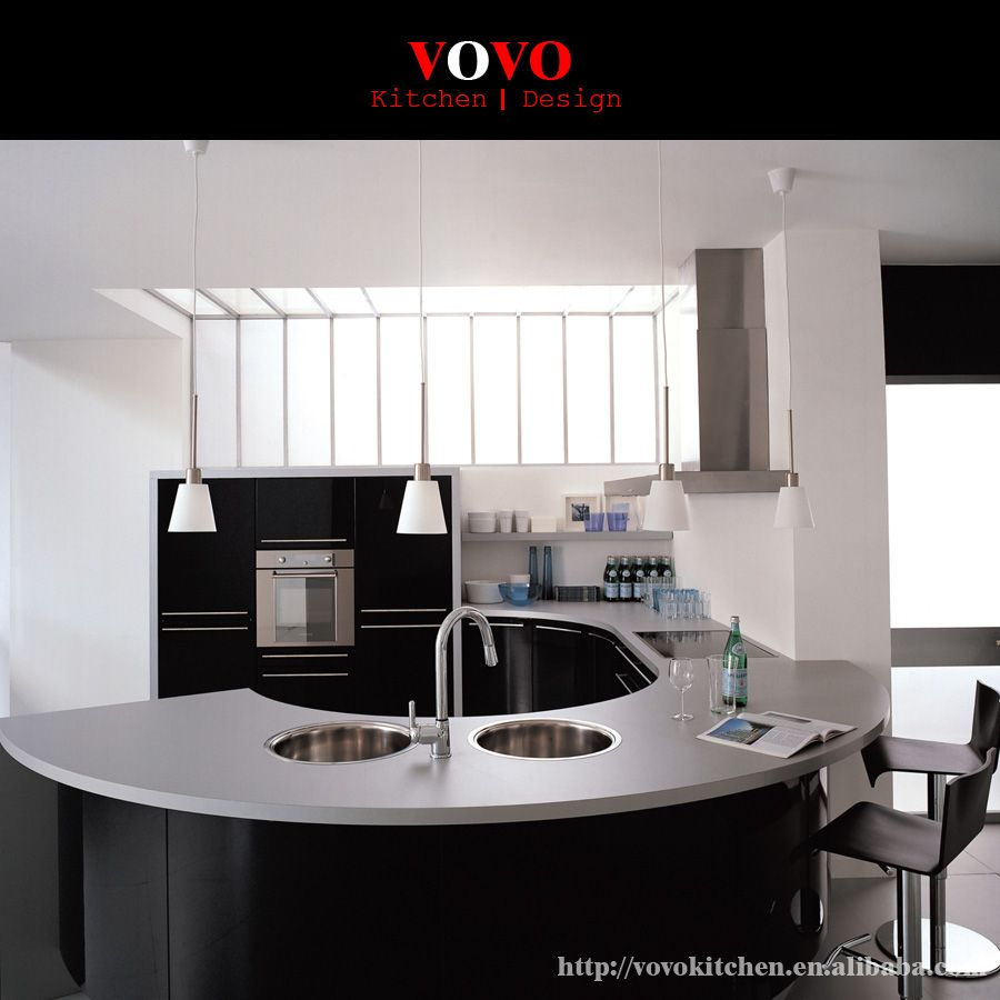 High gloss black integrated kitchen cabinets with elegant curved island and countertop