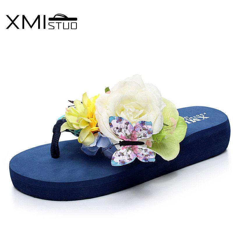 XMISTUO tongs femmes chaussures de plage d'été sont une pente de pincement de fleur antidérapant avec fond épais mignon doux série pantoufles