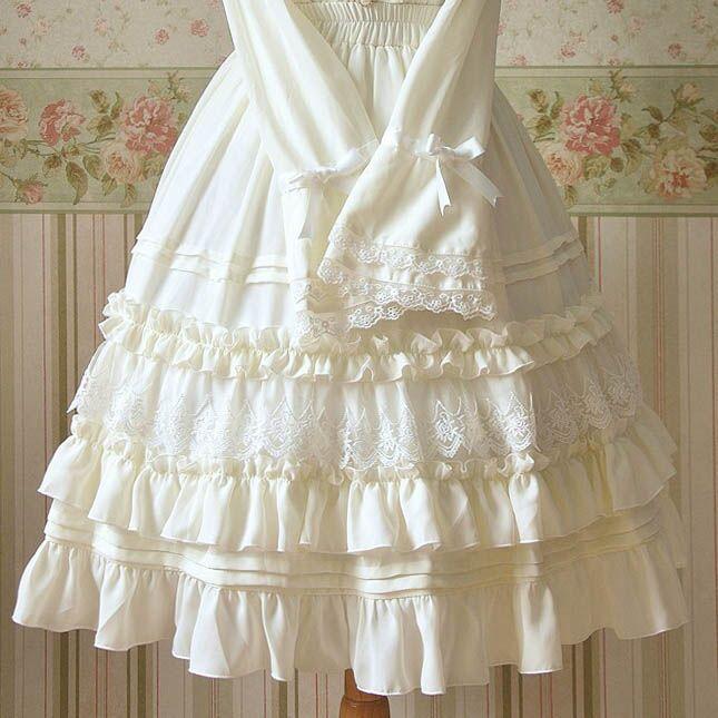 Femmes blanc noir Lolita genou longueur jupes en mousseline de soie dentelle volants doux Empire à plusieurs niveaux haute qualité princesse jupes taille élastique
