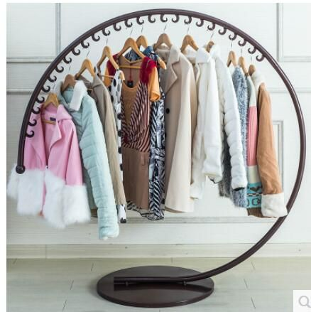 European-style iron art clothes hat stand on the floor of a fashion clothing store display rack