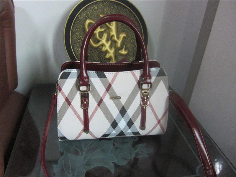 75usd bao1-6 mini shoulder bag female tide casual PU small backpack fashion woven pu and leather 5.25 baile Li