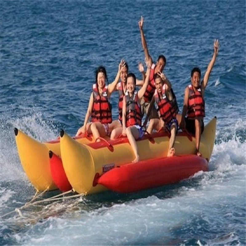 inflatable banana boat 6 people playing on the beach surf riding water game water toys