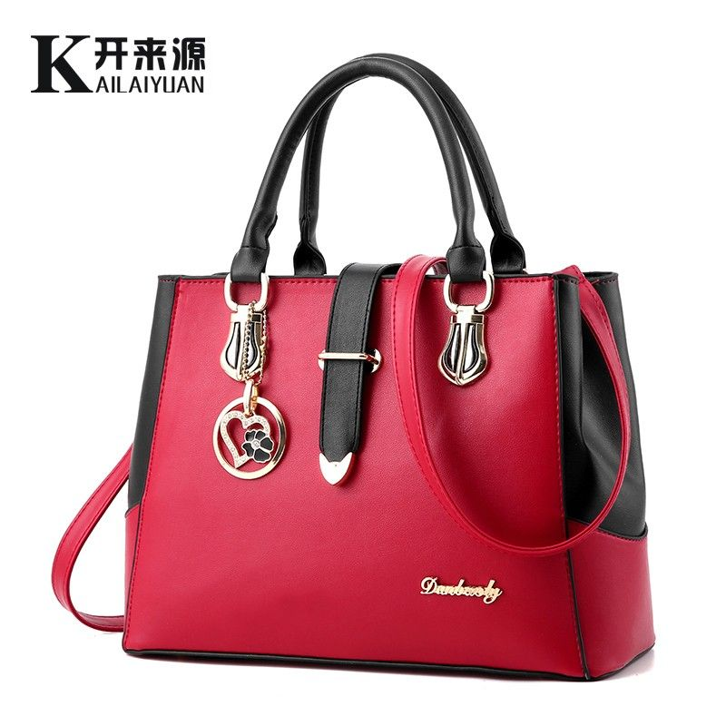 KLY 100% Echtem leder Frauen handtaschen 2018 Neue weibliche Koreanische mode handtasche Crossbody förmigen süße Schulter Handtasche